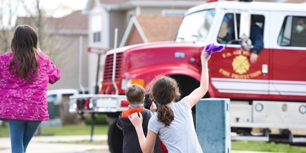 Kids waving to fire truck