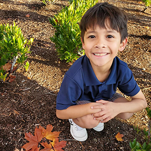 Young boy completing a nature activity