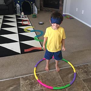 Preschooler playing camp games
