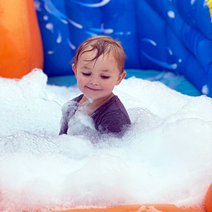 Toddler in bubbles