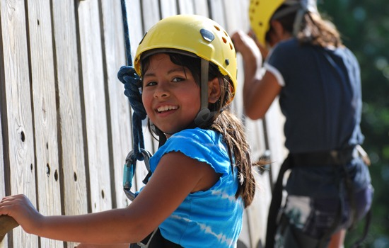 Operation Purple Camp: Girl climbs on rock wall