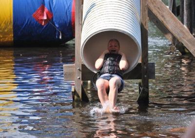 camper sliding down water slide